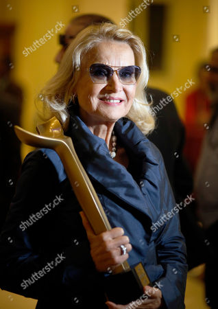 Barbara Bouchet, a German-American actress, holds her award after she was honored during the third edition of Aswan International Women Film Festival (AIWFF), in Aswan, Egypt, late