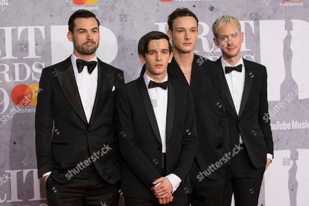 Matthew Healy, Ross MacDonald, George Daniel, Adam Hann. Members of 'The 1975', Matthew Healy, Ross MacDonald, George Daniel and Adam Hann pose for photographers upon arrival at the Brit Awards in London