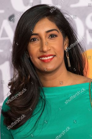 Tina Daheley poses for photographers upon arrival at the Brit Awards in London