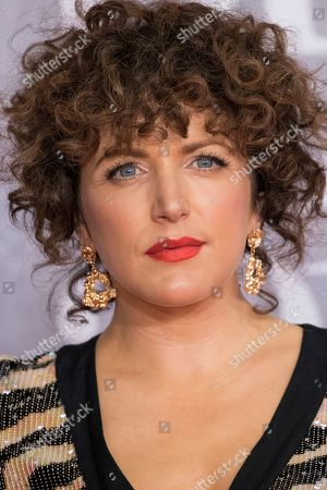 Annie Mac poses for photographers upon arrival at the Brit Awards in London