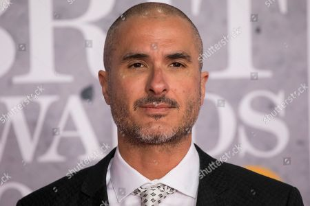 Zane Lowe poses for photographers upon arrival at the Brit Awards in London