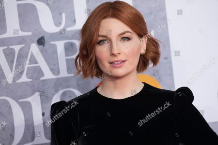 Alice Levine poses for photographers upon arrival at the Brit Awards in London