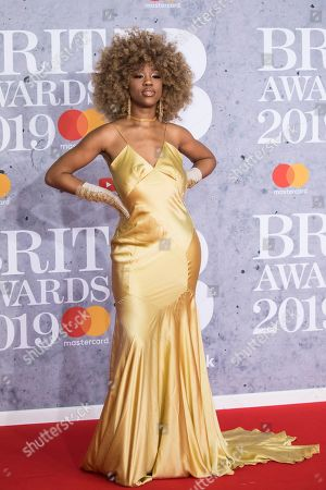 Chidera Eggerue poses for photographers upon arrival at the Brit Awards in London