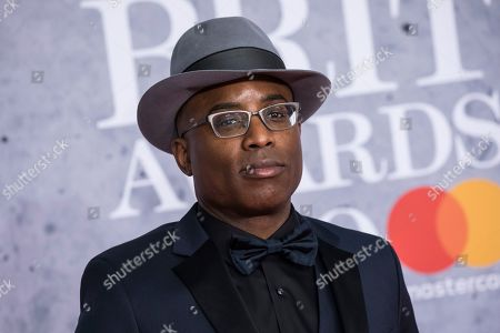 Alexis Ffrench poses for photographers upon arrival at the Brit Awards in London