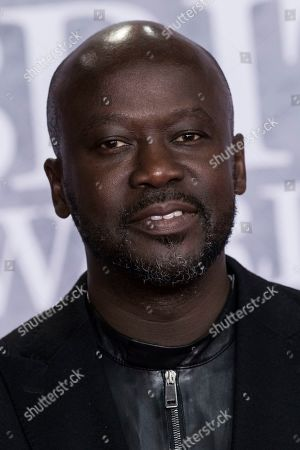 Stock Image of Sir David Adjaye poses for photographers upon arrival at the Brit Awards in London