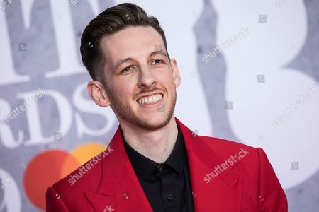 Bruce Fielder (Sigala) poses for photographers upon arrival at the Brit Awards in London