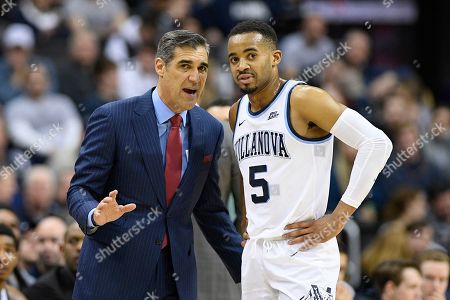 Villanova head coach Jay Wright, left, talks with guard Phil Booth, right, during the first half of an NCAA college basketball game against Georgetown, in Washington. Georgetown won 85-73