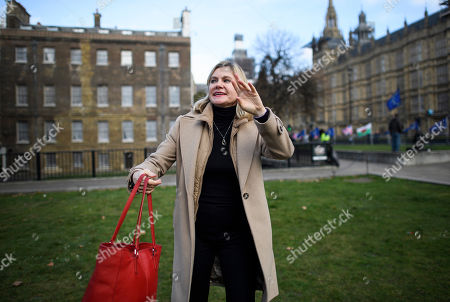 Justine Greening MP seen waving after speaking to media in Westminster, London. Conservative and Labour MPs have resigned form their respective parties. and joined newly formed The Independent Group, a breakaway campaign group formed by seven defecting Labour MPs.
