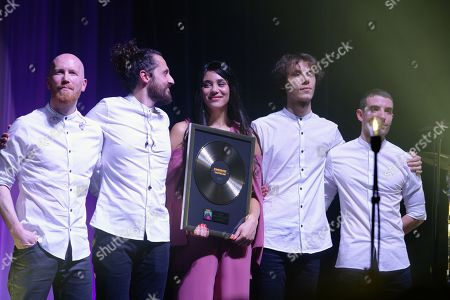 Kimberly Kitson Mills from the group Kimberose on stage at Olympia. She receives from Pascal Negre a golden record for her album Chapter One