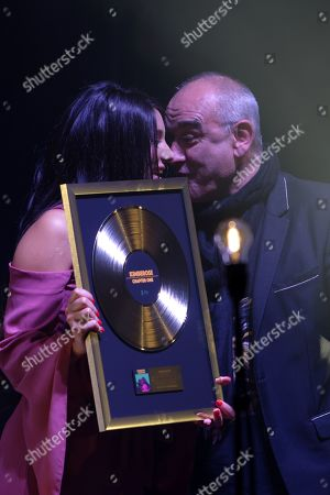 Stock Picture of Kimberly Kitson Mills from the group Kimberose on stage at Olympia. She receives from Pascal Negre a golden record for her album Chapter One