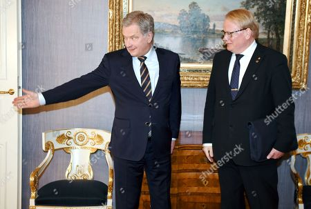 Finnish President Sauli Niinistö welcomes Swedish Defence Minister Peter Hultqvist at the Presidential Palace in Helsinki, Finland
