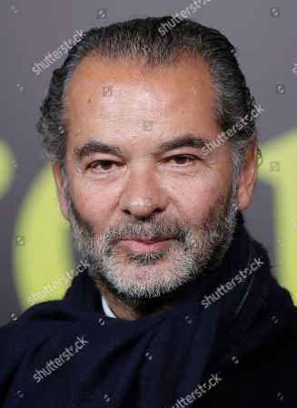 Moncler CEO Remo Ruffini poses during the presentation of the Moncler women's Fall-Winter 2019-2020 fashion collection, that was presented in Milan, Italy, Wednesday, Feb.20, 2019