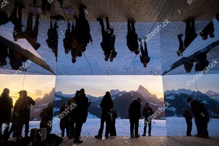 People visit the latest installation entitled 'Mirage Gstaad' by American artist Doug Aitken at Gstaad, Switzerland, 20 February 2019 (issued 21 February 2019). This structure, presented during the exposition 'Elevation 1049: Frequencies', will be visible for the next two years.