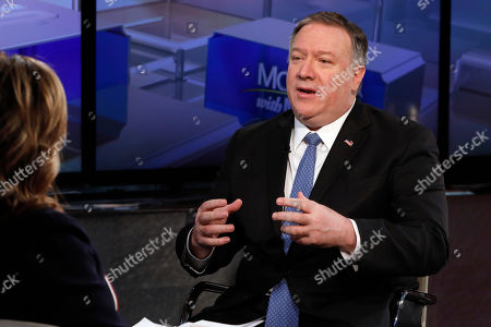 """U.S. Secretary of State Mike Pompeo is interviewed by Maria Bartiromo during her """"Mornings with Maria Bartiromo"""" program on the Fox Business Network, in New York . Pompeo said Hoda Muthana, who is now in a refugee camp in Syria along with others who fled the remnants of the Islamic State, has no legal claim to citizenship and will not be permitted to enter the country"""