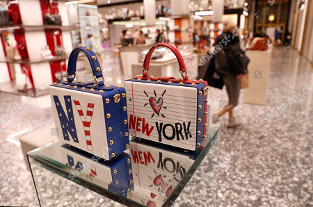New York-themed handbags are displayed at Saks Fifth Avenue's flagship midtown Manhattan store, in New York. Saks is in the last phase of what Saks president Marc Metrick calls a $250 million redevelopment just as luxury rivals Neiman Marcus and Nordstrom expand into the city. Metrick, 45, hopes the new look will reinvent the department store experience, namely bringing theater to luxury shopping at a time when shoppers can buy their designer handbags online