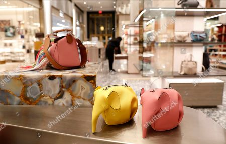 Elephant handbags are displayed at Saks Fifth Avenue's flagship and storied midtown Manhattan store, in New York. Saks is in the last phase of what company president Marc Metrick calls a $250 million redevelopment just as luxury rivals Neiman Marcus and Nordstrom expand into the city. Metrick, 45, hopes the new look will reinvent the department store experience, namely bringing theater to luxury shopping at a time when shoppers can buy their designer handbags online