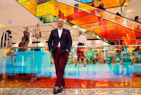 Saks Fifth Avenue President Marc Metrick poses for a photograph inside the company's storied midtown Manhattan store, in New York