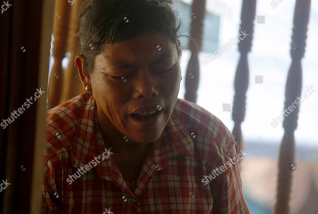 Mother of Ni Ni Soe mourns at MyinPhyu village in Buthidaung Township, northern Rakhine State, western Myanmar, 21 February 2019. Ni Ni Soe, an 18-year-old girl from the village, was killed in the fight between the Myanmar military and the Arakan Army (AA) on 20 February 2019 near MyinPyu village. Villagers said heavy weapons and bullets hit the houses in the village during the clash. According to the United Nations (UN), 4,500 residents fled from village shelters into temporary camps in Ponnagyun, Buthidaung, Rathetaung and Kyauktaw townships, as fighting continues between Myanmar military troops and the Arakan Army in northern Rakhine State. The Arakan Army, which was founded in 2009, has not taken part in the National Ceasefire Agreement (NCA).