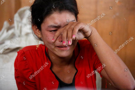 The elder sister of Ni Ni Soe mourns at MyinPhyu village in Buthidaung Township, northern Rakhine State, western Myanmar, 21 February 2019. Ni Ni Soe, an 18-year-old girl from the village, was killed in the fight between the Myanmar military and the Arakan Army (AA) on 20 February 2019 near MyinPyu village. Villagers said heavy weapons and bullets hit the houses in the village during the clash. According to the United Nations (UN), 4,500 residents fled from village shelters into temporary camps in Ponnagyun, Buthidaung, Rathetaung and Kyauktaw townships, as fighting continues between Myanmar military troops and the Arakan Army in northern Rakhine State. The Arakan Army, which was founded in 2009, has not taken part in the National Ceasefire Agreement (NCA).