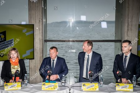 Tour de France race director Christian Prudhomme (2-R), Danish Prime Minister Lars Loekke Rasmussen (2-L), mayor of Roskilde Joy Mogensen (L) and commerce minister Rasmus Jarlov (R) hold press conference at the Viking Ship Museum in Roskilde, Denmark, 21 February 2019. The 2021 Tour de France cycling race will begin in Denmark with an opening stage in Copenhagen.