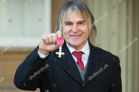 Welsh Musician Mike Peters is awarded an MBE for voluntary services to Cancer Care in North Wales and abroad at Buckingham Palace