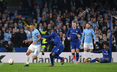 Chelsea's N'Golo Kante (R) vies for the ball with Malmo's Arnor Ingvi Traustason  (L) during the UEFA Europa League Round of 32 second leg soccer match Chelsea vs Malmo in London, Britain, 21 February 2019.