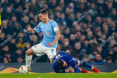 Malmö FF forward Markus Rosenberg (9) brings down Chelsea midfielder Ross Barkley (8) during the Europa League round of 32 leg 2 of 2 match between Chelsea and Malmo FF at Stamford Bridge, London