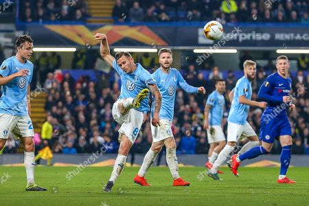 Malmö FF midfielder Arnor Ingvi Traustason (8) clears the ball during the Europa League round of 32 leg 2 of 2 match between Chelsea and Malmo FF at Stamford Bridge, London
