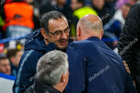 Chelsea Manager Mourizio Sarri and Malmö FF Manager Uwe Rosler greet each other before the Europa League round of 32 leg 2 of 2 match between Chelsea and Malmo FF at Stamford Bridge, London