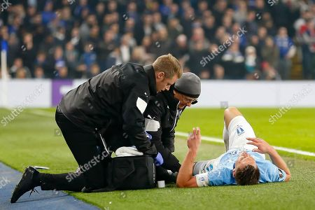 Malmo FF forward Markus Rosenberg (9) lies on the ground injured during the Europa League match between Chelsea and Malmo FF at Stamford Bridge, London