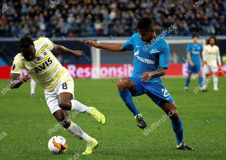Zenit's Wilmar Barrios (R) in action against  Fenerbahce's Victor Moses (L) during the UEFA Europa League round of 32 second leg soccer match between Zenit and Fenerbahce in St. Petersburg, Russia, 21 February 2019.