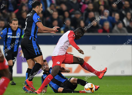 Bruegge's Sofyan Amrabat (L) and Bruegge's Siebe Schrijvers (C) in action with Salzburg's Diadie Samassekou (R) during the UEFA Europa League round of 32, second leg soccer match between FC Salzburg and Club Brugge in Salzburg, Austria, 21 February 2019.