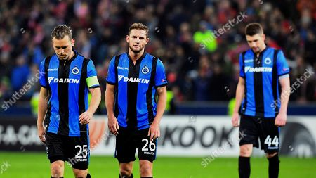 Brugge's Ruud Vormer, from left, Mats Rits and Brandon Mechele leave the pitch after the Europa League round of 32 second leg soccer match between FC Salzburg and Club Brugge in the Arena in Salzburg, Austria, on