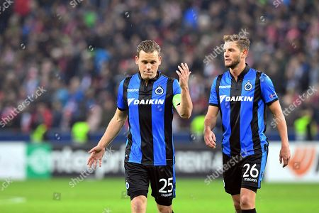 Brugge's Ruud Vormer, left, and Mats Rits leave the pitch after the Europa League round of 32 second leg soccer match between FC Salzburg and Club Brugge in the Arena in Salzburg, Austria, on