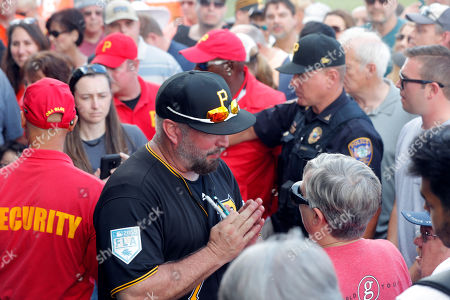 be442d8dd22168 Stock Image of Country Music star Garth Brooks mingles with fans during  Pittsburgh Pirates workouts at