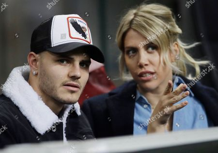 Inter Milan's Mauro Icardi is flanked by his wife Wanda Nara during the Europa League, round of 32, second leg soccer match between Inter Milan and SK Rapid Vienna, at the San Siro stadium in Milan, Italy