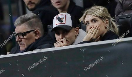 Inter Milan's Mauro Icardi is flanked by his wife Wanda Nara and his father Juan, during the Europa League, round of 32, second leg soccer match between Inter Milan and SK Rapid Vienna, at the San Siro stadium in Milan, Italy
