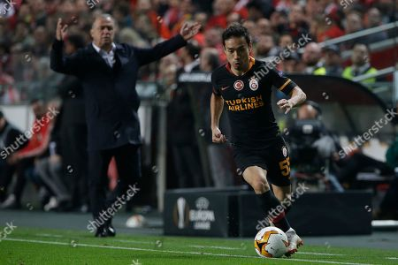 Galatasaray defender Yuto Nagatomo, right, goes for the ball during the Europa League round of 32, second leg, soccer match between Benfica and Galatasaray at the Luz stadium in Lisbon