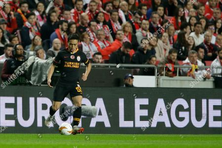 Galatasaray defender Yuto Nagatomo plays the ball during the Europa League round of 32, second leg, soccer match between Benfica and Galatasaray at the Luz stadium in Lisbon