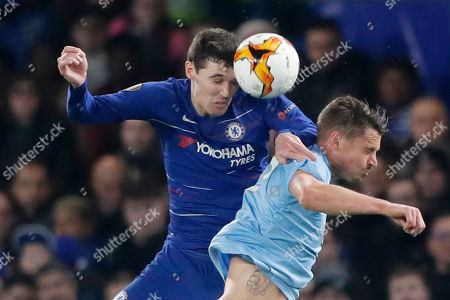 Chelsea's Andreas Christensen, left, and Malmo's Markus Rosenberg jump to head the ball during the round of 32, second leg, Europa League soccer match between Chelsea and Malmo FF at Stamford Bridge stadium in London