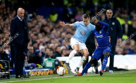 Ngolo Kante of Chelsea  tackles Arnor Ingvi Traustason of Malmo FF watched by Malmo FF manager Uwe Rosler& Chelsea Manager Maurizio Sarri