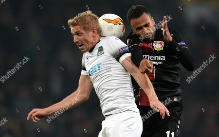 Leverkusen's Isaac Kiese Thelin (R) in action with Krasnodar's Yuri Gazinskiy (L) during the UEFA Europa League round of 32 second leg soccer match between Bayer Leverkusen and FK Krasnodar in Leverkusen, Germany, 21 February 2019.