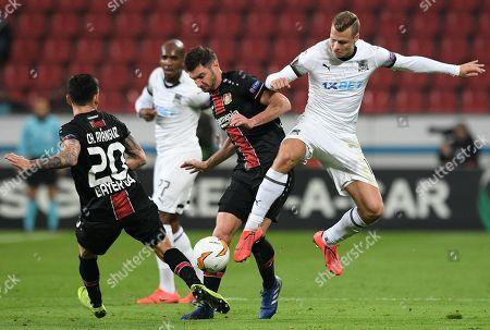 Leverkusen's Charles Aranguiz (L) and Lucas Alario (C) in action with Krasnodar's Victor Claesson (R) the UEFA Europa League round of 32 second leg soccer match between Bayer Leverkusen and FK Krasnodar in Leverkusen, Germany, 21 February 2019.