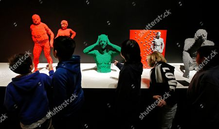 School children look at sculptures that are part of 'The Art Of The Brick' traveling exhibition of art made out of Lego's appearing at the Perot Museum of Nature and Science in Dallas, Texas, USA, 21 February 2019. The artist Nathan Sawaya was a former New York City corporate lawyer.