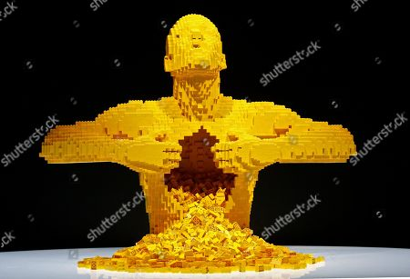 A view of the sculpture 'Yellow' that is part of 'The Art Of The Brick' traveling exhibition of art made out of Lego's appearing at the Perot Museum of Nature and Science in Dallas, Texas, USA, 21 February 2019. The artist Nathan Sawaya was a former New York City corporate lawyer.
