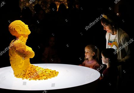 People look at the sculpture 'Yellow' that is part of 'The Art Of The Brick' traveling exhibition of art made out of Lego's appearing at the Perot Museum of Nature and Science in Dallas, Texas, USA, 21 February 2019. The artist Nathan Sawaya was a former New York City corporate lawyer.