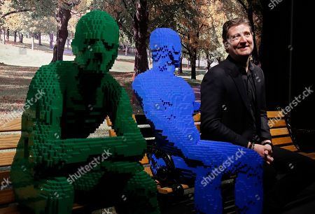 Artist Nathan Sawaya (R) sits next to some of his art forms that is part of The Art Of The Brick traveling exhibition of art made out of Lego's, appearing at the Perot Museum of Nature and Science in Dallas, Texas, USA, 21 February 2019. The artist Nathan Sawaya was a former New York City corporate lawyer.