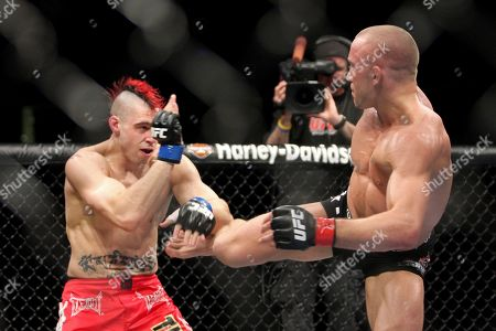 Stock Picture of Dan Hardy, Georges St. Pierre. Georges St. Pierre, right, in action against Dan Hardy in their UFC 111 fight at the Prudential Center in Newark, NJ on . St. Pierre retained his title via 5-round unanimous decision