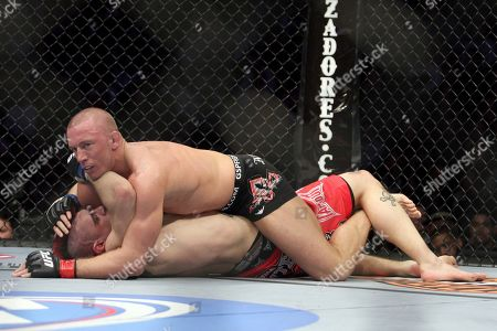 Stock Picture of Dan Hardy, Georges St. Pierre. Georges St. Pierre, top, in action against Dan Hardy in their UFC 111 fight at the Prudential Center in Newark, NJ on . St. Pierre retained his title via 5-round unanimous decision