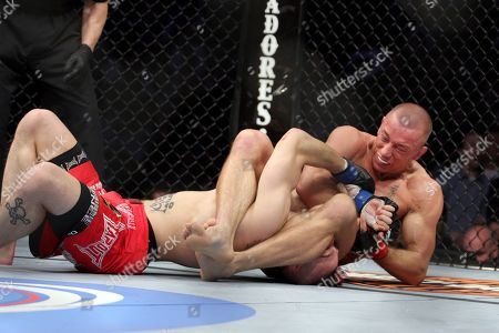 Dan Hardy, Georges St. Pierre. Georges St. Pierre, right, attempts an armbar against Dan Hardy in their UFC 111 fight at the Prudential Center in Newark, NJ on . St. Pierre retained his title via 5-round unanimous decision